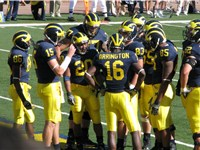 2007 Michigan Wolverines football team huddle with Mario Manningham (86), Ryan Mallett (15), Mike Ha