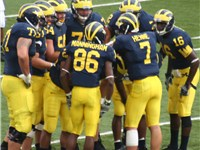 2006 Michigan Wolverines football team huddle with #86 Mario Manningham, #7 Chad Henne, #16 Arringto