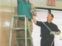 Then President Bill Clinton installing computer cables with Vice President Al Gore on NetDay at Ygna