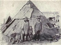 An Inuit family with a Malamute from 1915.