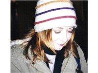 Hannigan outside the stage door after When Harry Met Sally... in London, in May 2004.