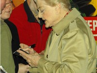 Signing autographs after performing in Blithe Spirit, 2009.