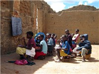 Children in an outdoor classroom in Bi , Angola