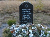 Memorial for Margot and Anne Frank at the former Bergen-Belsen site, along with floral and pictorial