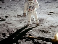 Buzz Aldrin poses on the Moon allowing Neil Armstrong to photograph both of them using the visor's r