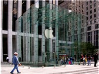The entrance of the Apple Store on Fifth Avenue in New York City is a glass cube, housing a cylindri