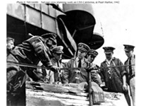 Captain Homer N. Wallin (center) supervises salvage operations aboard USS California, early 1942