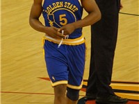 Davis in the Warriors retro jersey