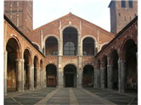 The hut façade of Sant'Ambrogio with the entrance portico.
