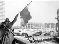 Red Army soldier waves flag after victory
