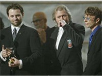 Maurice's son Adam, Barry & Robin accepting the Grammy Legend Award in 2003