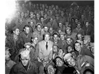 Bob Hope sits with men of X Corps, as members of his troupe entertain at Womsan, Korea. October 26,