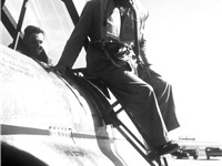 Bob Hope in Korea climbing out of a T-33 Shooting Star, which flew him from Taegu to Kimpo airfield