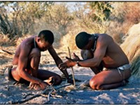 Starting fire by hand. Bushmen in Botswana.