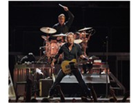 Springsteen performing with drummer Max Weinberg behind him, on the Magic Tour stop at Veterans Memo