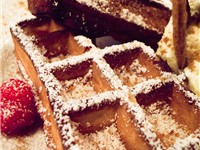 Brussels is known for its local waffle (pictured) and chocolate.