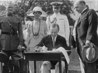 Coolidge signing the Immigration Act and some appropriation bills. General John J. Pershing looks on