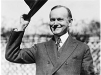 President Coolidge signed a bill granting Native Americans full U.S. citizenship. Coolidge is shown