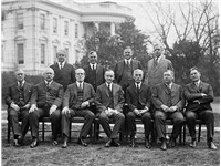 Coolidge's cabinet in 1924, outside the White House Front row, left to right: Harry Stewart New, Joh