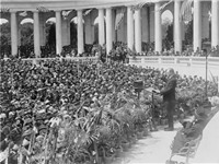Coolidge addressing a crowd at Arlington National Cemetery's Roman style Memorial Amphitheater in 19