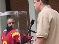 Palmer and his retired jersey at USC.