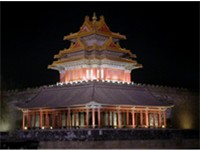 A corner tower of the Forbidden City at night; the palace served as the residence for the imperial f