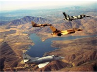 TOPGUN F-16 and A-4 aircraft in formation over Lower Otay Lake prior to development.