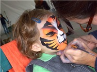 A young girl gets her face painted at Cirque's Fte Foraine.