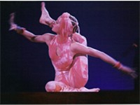 An acrobat performs in the contortion act of Nouvelle Exp rience.