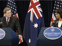 Rice and Australian Foreign Minister Alexander Downer participate in a news conference at the Ronald