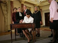 Rice signs official papers after receiving the oath of office during her ceremonial swearing in at t