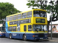 The typical blue and yellow double Dublin Bus.