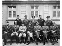 Eisenhower (seated, middle) with other US Army officers, 1945. From left to right, the front row inc