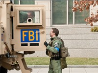 FBI agents from the Washington Field Office with one of the tactical vehicles they had standing by f
