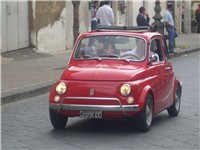 Restored vintage Fiat 500 in a street race in Sicily