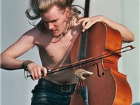 Apocalyptica's Perttu Kivilaakso playing metal music live.