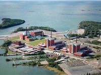 Olkiluoto Nuclear Power Plant with two existing units. On the far left is a visualization of the thi