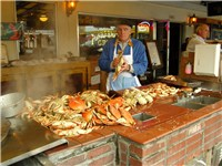 Tourists enjoy dungeness crab at Fisherman's Wharf.