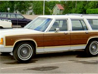 The Ford Country Sedan was identical to the Ford Country Squire pictured here, without the pseudo-wo