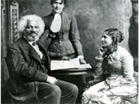 Frederick Douglass with his second wife Helen Pitts Douglass (sitting). The woman standing is her si
