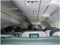 Interior of a typical Frontier Airlines cabin. Note the standard in-seat entertainment modules. also