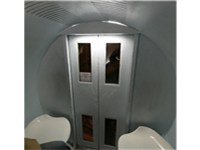 Entrance doors as viewed from inside the tram capsule.