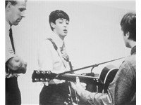 Martin previewing a song by Lennon and McCartney in 1963.