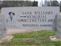 This stone marks the entrance to the Oakwood Cemetery in Montgomery, Alabama where Williams is inter