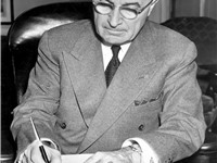 President Truman signing a proclamation declaring a national emergency that initiates U.S. involveme