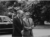 Ford and Kissinger conversing on grounds of White House, August 1974