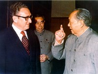Kissinger, shown here with Zhou Enlai and Mao Zedong, negotiated rapprochement with the People's Rep