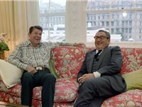 Kissinger meeting with President Ronald Reagan in the White House family quarters, 1981