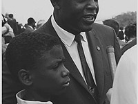 Robinson and his son David (then age 11) are interviewed during the March on Washington, August 28,