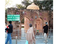 Bullet marks, visible on a preserved wall, at present-day Jallianwala Bagh.